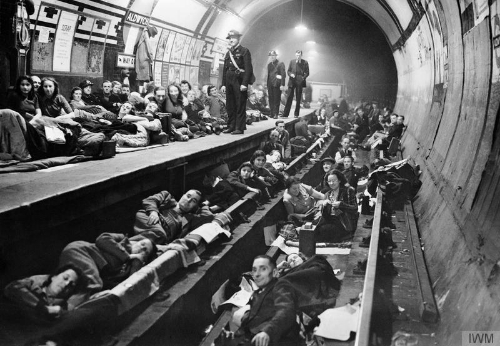 civilians shelter underground during a World War II air raid